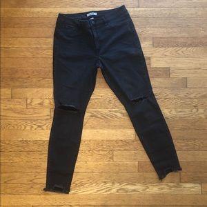 Distressed black skinny jean